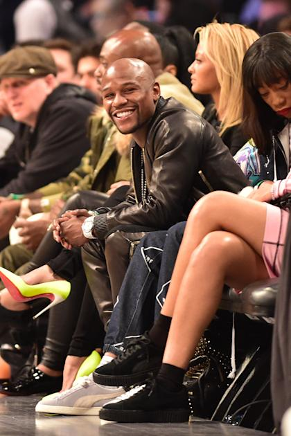 Floyd Mayweather watches the Three-Point Contest at All-Star Saturday Night. (USAT)