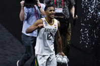 Baylor guard Jared Butler (12) celebrates as he walks off the court at the end of a men's Final Four NCAA college basketball tournament semifinal game against Houston, Saturday, April 3, 2021, at Lucas Oil Stadium in Indianapolis. Baylor won 78-59. (AP Photo/Darron Cummings)