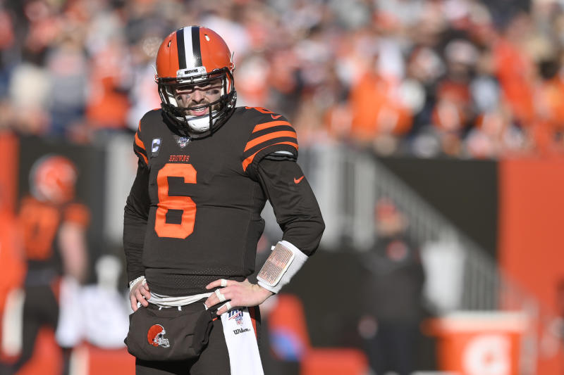 FILE - In this Dec. 22, 2019, file photo, Cleveland Browns quarterback Baker Mayfield reacts during an NFL football game against the Baltimore Ravens in Cleveland. A Cleveland sports talk radio personality has been suspended indefinitely for referring to Browns quarterback Baker Mayfield as a midget. During a commercial break at the NFL scouting combine in Indianapolis, ESPN Cleveland's Tony Grossi didn't realize his microphone was still on when he used a vulgar word before calling Mayfield a midget. (AP Photo/David Richard, File)