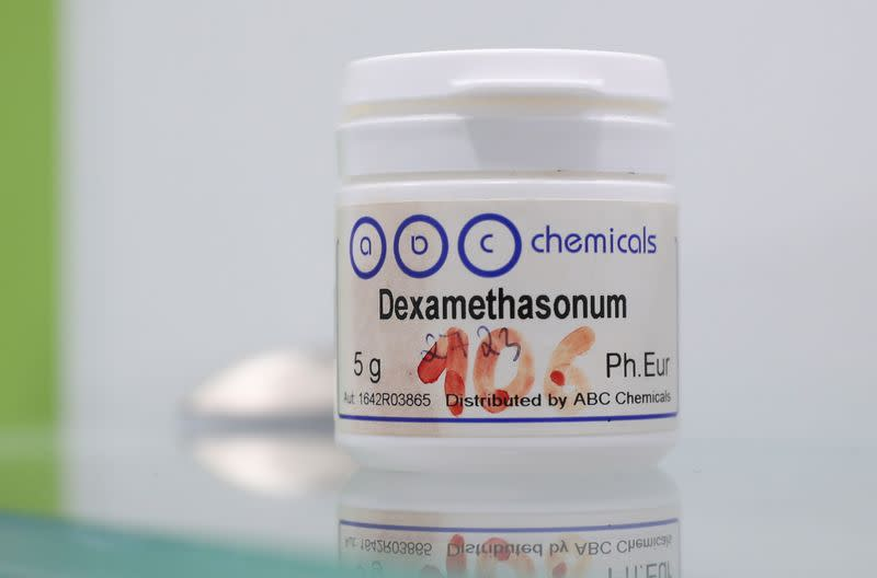 FILE PHOTO: An ampoule of Dexamethasone is seen on a glass in this picture illustration