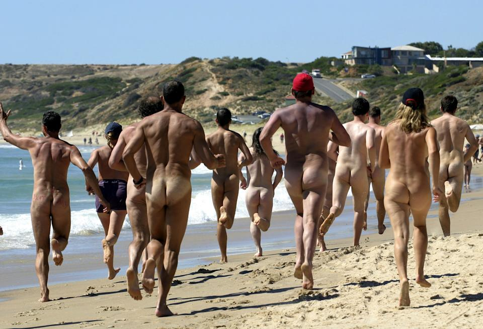 Rear view of Streakers competing in the marathon event during the 30th annual Nude Olympics on Maslin Beach near Adelaide, 23 January 2005