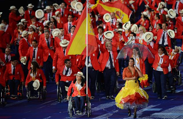 LONDON, ENGLAND - AUGUST 29: Swimmer Teresa Perales of Spain carries the flag during the Opening Ceremony of the London 2012 Paralympics at the Olympic Stadium on August 29, 2012 in London, England. (Photo by Gareth Copley/Getty Images)