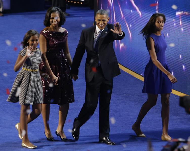 President Barack Obama and his family, Michele, Sasha, left and Malia, right exit the stage at the Democratic National Convention in Charlotte, N.C., on Thursday, Sept. 6, 2012. (AP Photo/Lynne Sladky)