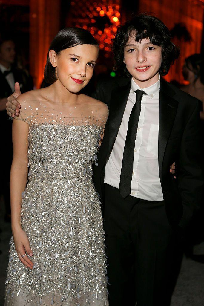 "<p>Millie Bobby Brown described her first kiss with Finn Wolfhard on the set of <em>Stranger Things</em> as the ""most awkward thing in the world,"" and for a perfectly good reason.</p><p>""My dad was watching. My dad watched the whole thing, my whole family was there, and it was the most awkward thing in the world. It's awkward,"" <a href=""https://www.mirror.co.uk/tv/tv-news/stranger-things-star-millie-bobby-17481960"" rel=""nofollow noopener"" target=""_blank"" data-ylk=""slk:she said."" class=""link rapid-noclick-resp"">she said. </a>""It's awkward, we're 15 years old. It's not like, all right, let's just do it. We're obviously like, 'Okay… what do you wanna do now? Shall we hug?' No idea what to do. There's not really preparation.""</p>"
