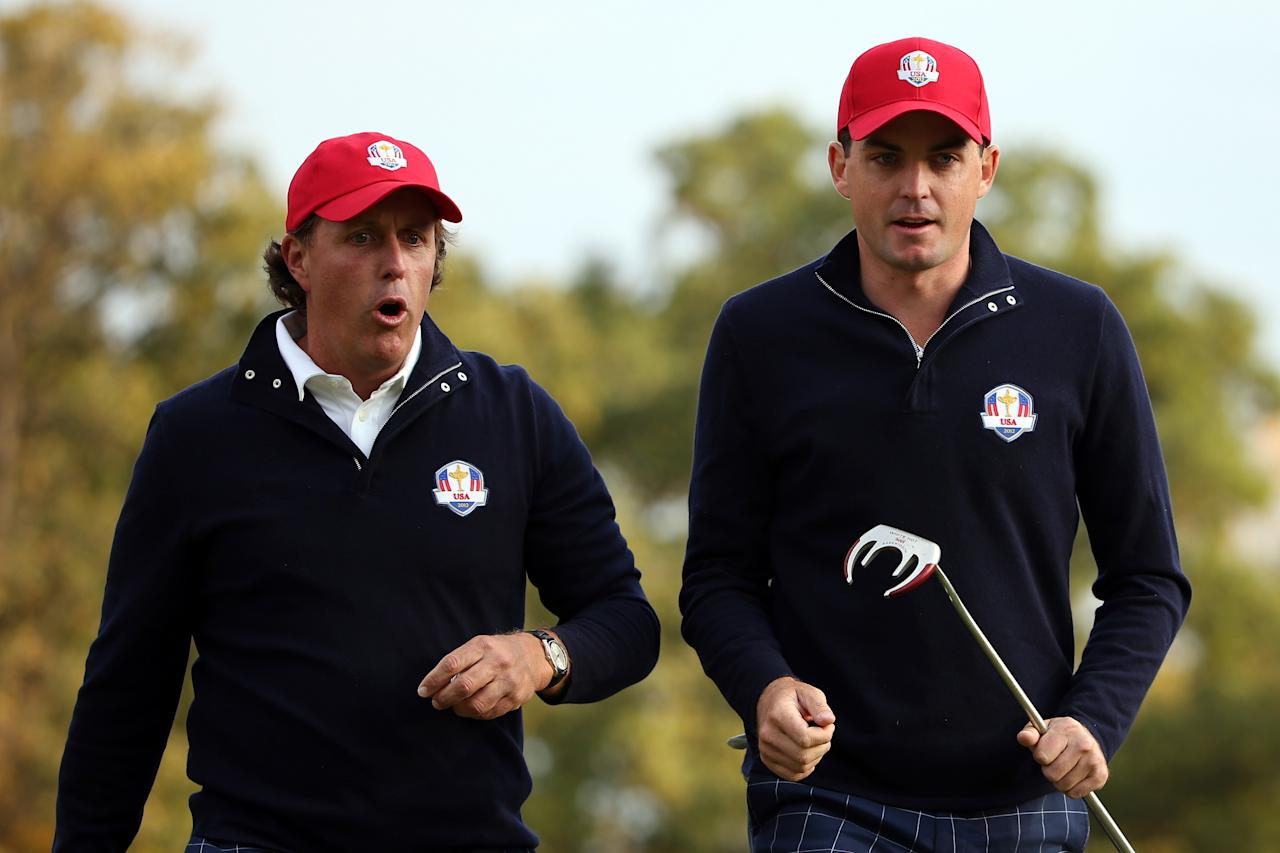 MEDINAH, IL - SEPTEMBER 28:  Phil Mickelson and Keegan Bradley of the USA wait on a green during the Morning Foursome Matches for The 39th Ryder Cup at Medinah Country Club on September 28, 2012 in Medinah, Illinois.  (Photo by Ross Kinnaird/Getty Images)