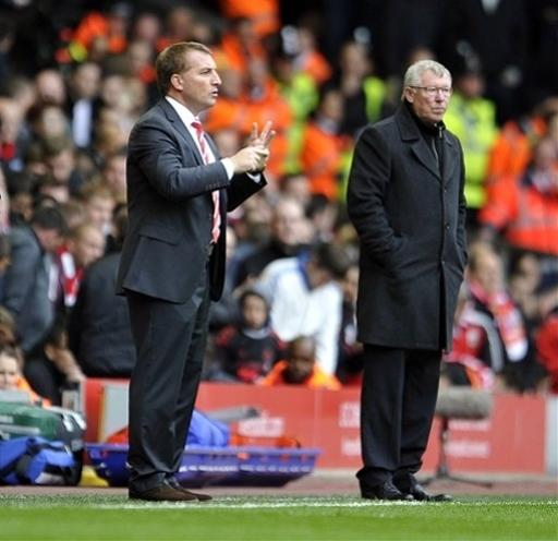 Liverpool's manager Brendan Rodgers, left and Manchester United's manager Alex Ferguson during an English Premier League soccer match between Manchester United and Liverpool at Anfield in Liverpool, England, Sunday Sept. 23, 2012. (AP Photo/Clint Hughes)
