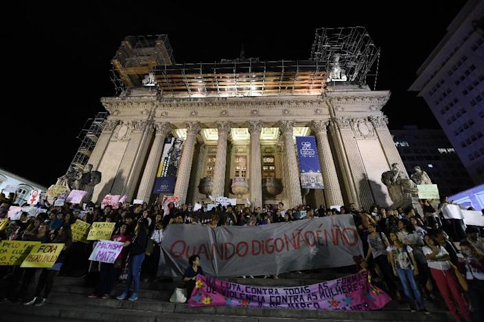 Brazilians protest in front of the Legislative Assembly of Rio de Janeiro (ALERJ) on May 27, 2016, against a gang-rape of a 16-year-old girl (AFP Photo/Vanderlei Almeida)