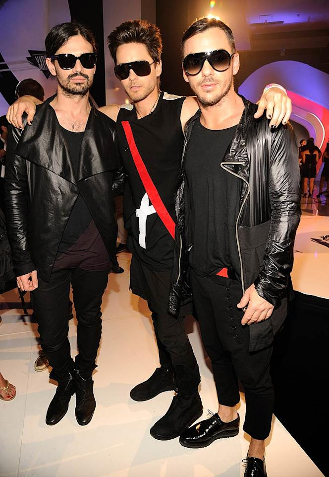 """Jared Leto (center) and his 30 Seconds to Mars bandmates Shannon Leto (right) and Tomo Milicivec (left) were outfitted in head-to-toe black for the fete. Do you think they're trying a little too hard to be cool? Kevin Mazur/<a href=""""http://www.wireimage.com"""" target=""""new"""">WireImage.com</a> - August 28, 2011"""