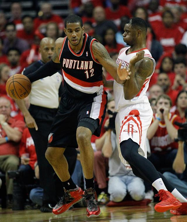 HOUSTON, TX - APRIL 20: LaMarcus Aldridge #12 of the Portland Trail Blazers backs in on Terrence Jones #6 of the Houston Rockets in Game One of the Western Conference Quarterfinals during the 2014 NBA Playoffs at the Toyota Center on April 20, 2014 in Houston, Texas. (Photo by Bob Levey/Getty Images)