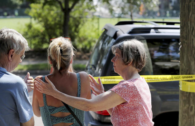 <p>Former Minnehaha Academy employees Elizabeth Van Pilsum, center, is comforted by friends Edie Olson, right, and Rick Olson, left, after an explosion at Minnehaha Academy Aug. 2, 2017, in Minneapolis. (David Joles/Star Tribune via AP) </p>