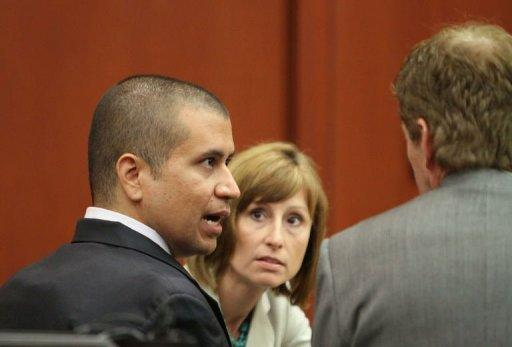 George Zimmerman (L) talks to his attorney Mark O'Mara during his bond hearing in Sanford, Florida, on April 20