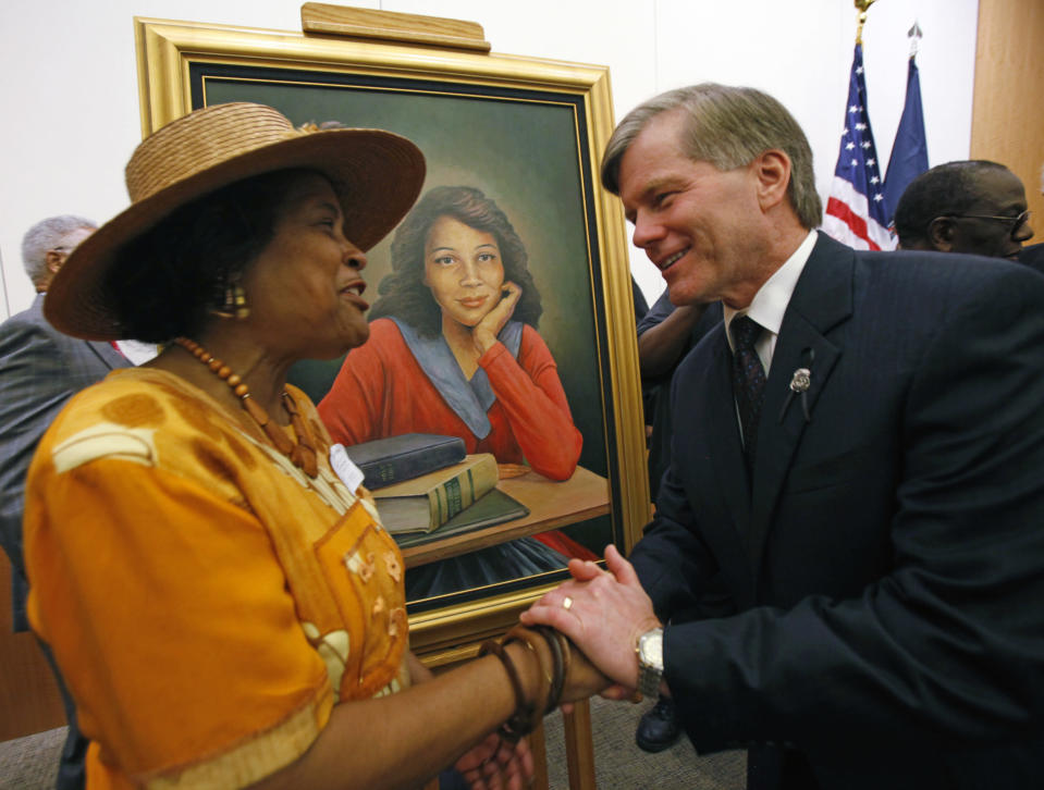 FILE - In this Sept. 17, 2010, file photo, Joan Cobbs, left, sister of civil rights legend Barbara Johns, shakes hands with Virginia Gov. Bob McDonnell, right, after a portrait of Barbara Johns, center, was unveiled in the Virginia State Capitol in Richmond, Va. There will soon be a statue saluting Virginia's Barbara Johns, a 16-year-old Black girl who staged a strike in 1951 over unequal conditions at her segregated high school in Farmville. Her actions led to court-ordered integration of public schools across the U.S, via the landmark Supreme Court decision, Brown v. Board of Education. (Bob Brown/Richmond Times-Dispatch via AP)