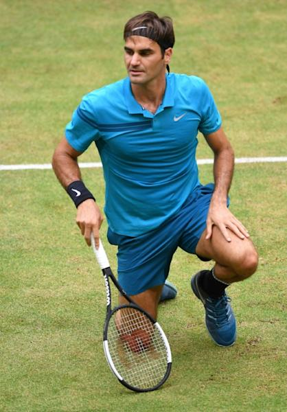 Down and out: Roger Federer on his way to defeat against Borna Coric in Halle on Sunday