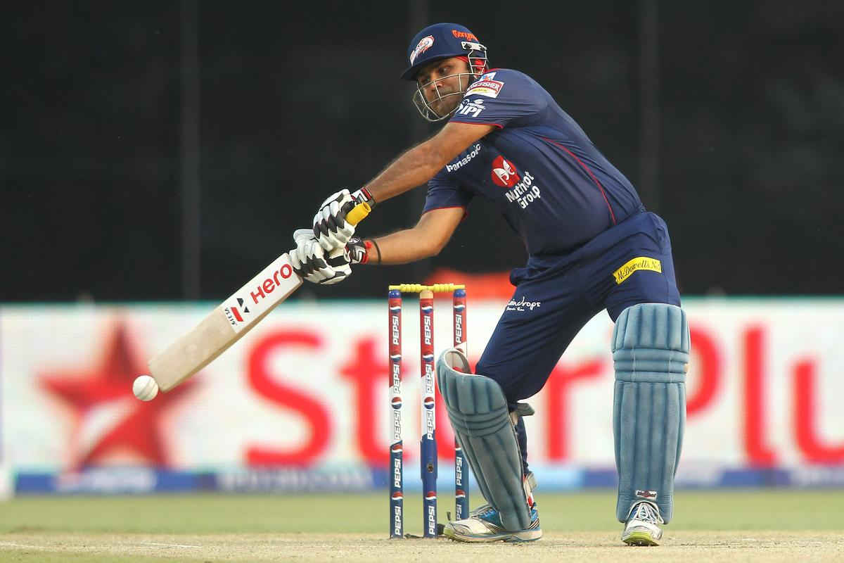 Virender Sehwag of Delhi Daredevils stretches for a wide delivery during match 28 of the Pepsi Indian Premier League between The Delhi Daredevils and the Mumbai Indians held at the Feroz Shah Kotla Stadium, Delhi on the 21st April 2013..Photo by Shaun Roy-IPL-SPORTZPICS ..Use of this image is subject to the terms and conditions as outlined by the BCCI. These terms can be found by following this link:..https://ec.yimg.com/ec?url=http%3a%2f%2fwww.sportzpics.co.za%2fimage%2fI0000SoRagM2cIEc&t=1502971237&sig=._nzhXf3DR2dn2VYhm2uMQ--~D