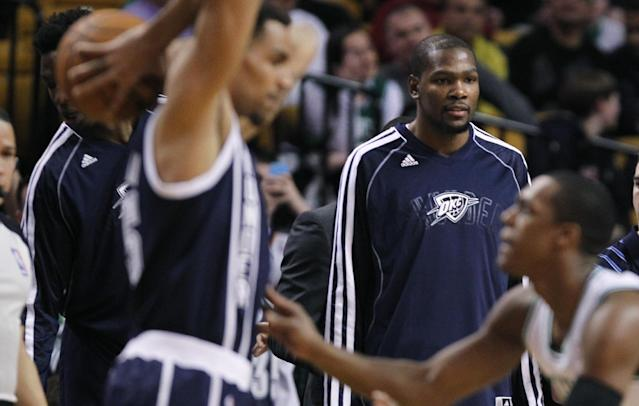 Oklahoma City Thunder forward Kevin Durant watches his team's NBA basketball game against the Boston Celtics during the first quarter in Boston, Friday, Jan. 24, 2014. Durant did not start in the game. (AP Photo/Charles Krupa)