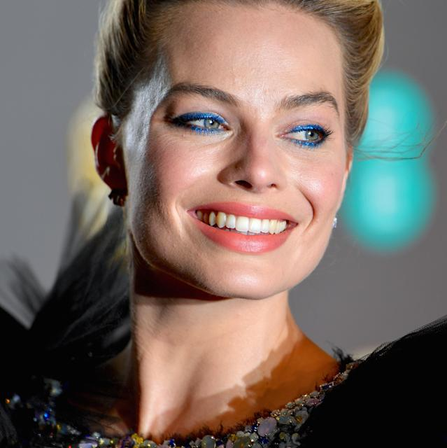 "Just when we thought <a href=""https://www.allure.com/topic/margot-robbie?mbid=synd_yahoo_rss"" rel=""nofollow noopener"" target=""_blank"" data-ylk=""slk:Margot Robbie"" class=""link rapid-noclick-resp"">Margot Robbie</a>'s eyes couldn't be a brighter shade of blue, makeup artist <a href=""https://www.instagram.com/patidubroff/"" rel=""nofollow noopener"" target=""_blank"" data-ylk=""slk:Pati Dubroff"" class=""link rapid-noclick-resp"">Pati Dubroff</a> proves us wrong with her BAFTA look. Dubroff enveloped Robbie's eyes with a thick, slightly smudgy application of electric-blue liner, made even more vibrant with a generous coat of matching blue mascara on upper and lower lashes."