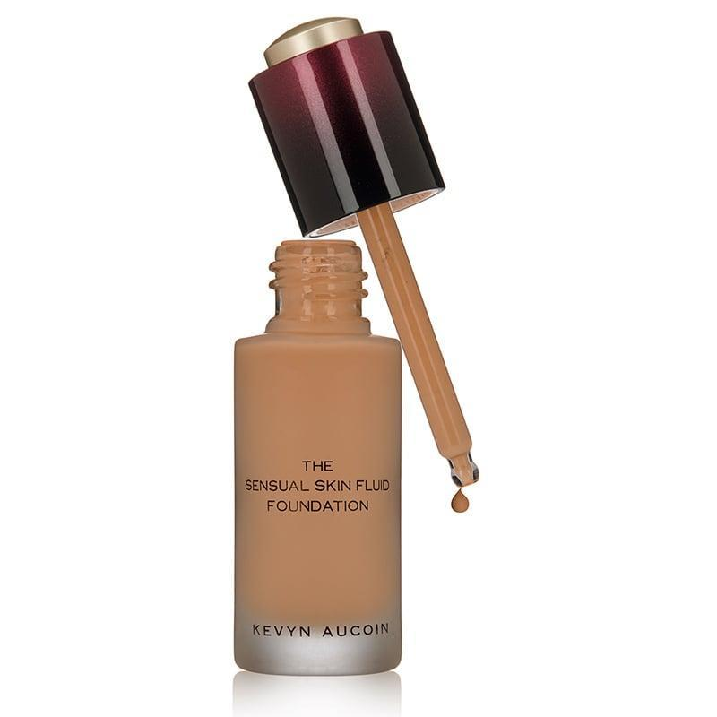 """<p>""""The <a href=""""https://www.popsugar.com/buy/Kevyn-Aucoin-Sensual-Skin-Fluid-Foundation-585115?p_name=Kevyn%20Aucoin%20The%20Sensual%20Skin%20Fluid%20Foundation&retailer=dermstore.com&pid=585115&price=52&evar1=bella%3Aus&evar9=43881299&evar98=https%3A%2F%2Fwww.popsugar.com%2Fbeauty%2Fphoto-gallery%2F43881299%2Fimage%2F47576644%2FKevyn-Aucoin-Sensual-Skin-Fluid-Foundation&list1=makeup%2Cbeauty%20products%2Cacne%2Cbeauty%20shopping%2Cbeauty%20tips%2Cbeauty%20interview%2Cbeauty%20news%2Cskin%20care&prop13=mobile&pdata=1"""" class=""""link rapid-noclick-resp"""" rel=""""nofollow noopener"""" target=""""_blank"""" data-ylk=""""slk:Kevyn Aucoin The Sensual Skin Fluid Foundation"""">Kevyn Aucoin The Sensual Skin Fluid Foundation</a> ($52) offers oil-free, ultralight coverage. It feels more like a luxury serum than a foundation but gives you a flawless finish every time."""" - Irwin</p>"""