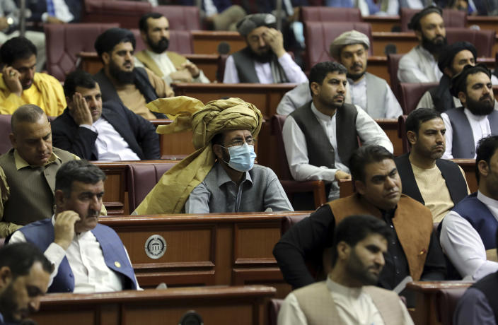 Parliament members listen to a speech by President Ashraf Ghani during the extraordinary meeting of the Parliament in Kabul, Afghanistan, Monday, Aug. 2, 2021. (AP Photo/Rahmat Gul)