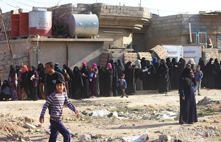 Women lined up waiting to get aid from Iraq's Interior Ministry. (Ash Gallagher for Yahoo News)
