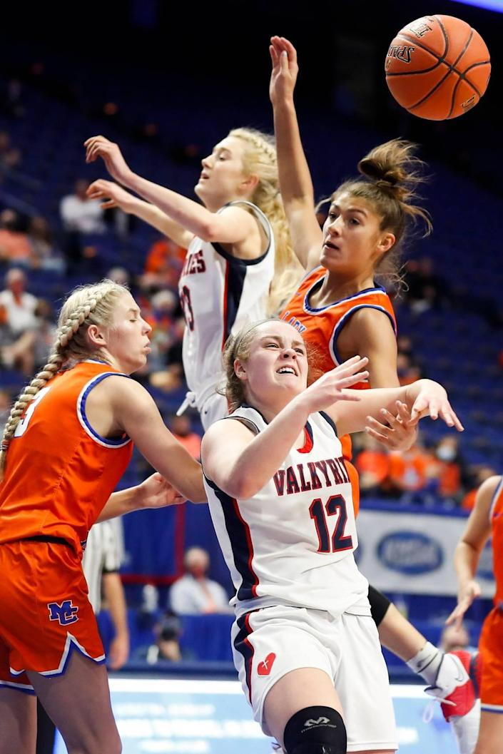 Marshall County's Jada Driver (3) and Sophie Galloway (32) battle Sacred Heart's Josie Gilvin (33) and Claire Russell (12) for a rebound during Saturday's state finals.