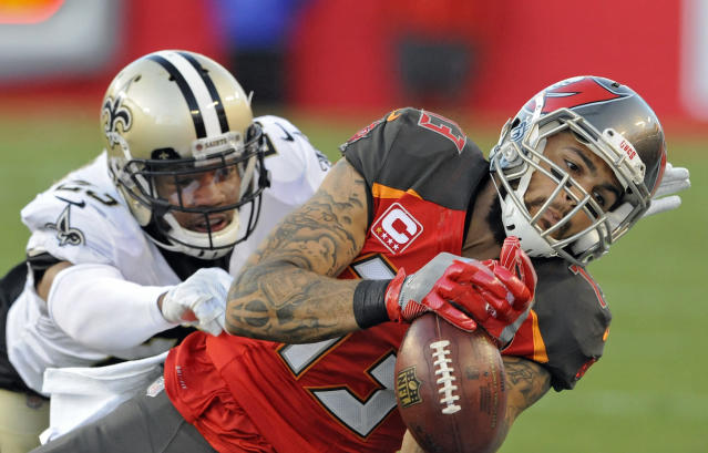 """<a class=""""link rapid-noclick-resp"""" href=""""/nfl/teams/tam"""" data-ylk=""""slk:Tampa Bay Buccaneers"""">Tampa Bay Buccaneers</a> wide receiver <a class=""""link rapid-noclick-resp"""" href=""""/nfl/players/27535/"""" data-ylk=""""slk:Mike Evans"""">Mike Evans</a> could bounce owners from the playoffs, despite what appears to be a terrific matchup. (AP Photo/Steve Nesius)"""