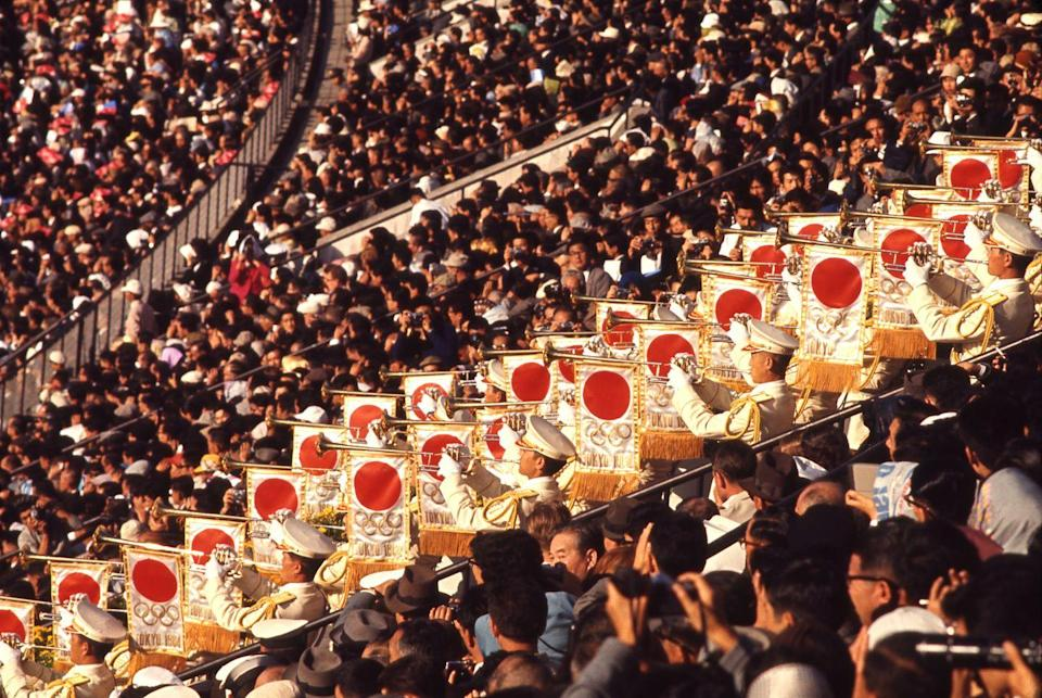 <p>Japan opted to incorporate the crowd into their opening ceremony fanfare. While hosting the 1964 Summer Olympic Games, the nation placed a group of trumpeters in the stands. </p>