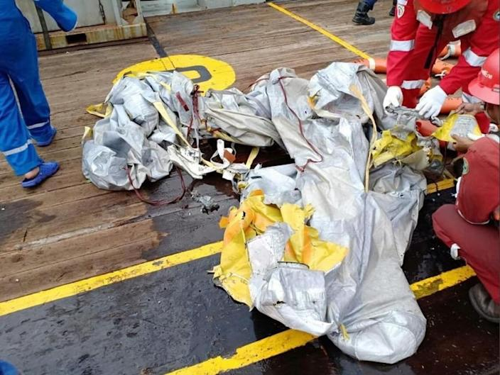 Debris apparently from the crashed jet was pulled out of the water (AFP Photo/Handout)