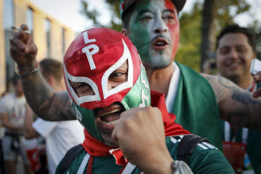 Mexico soccer fans celebrate their team victory against Germany after their group F match at the 2018 soccer World Cup in the Luzhniki Stadium in Moscow, Russia, Sunday, June 17, 2018. (AP Photo/Alexander Zemlianichenko)