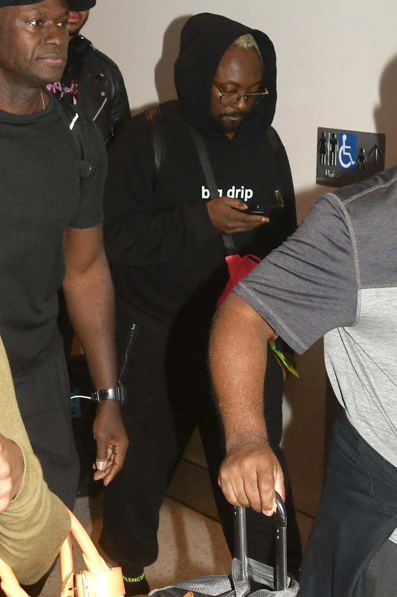 Will.i.am was escorted through the airport after the now well-publicised incident. Photo: DIIMEX