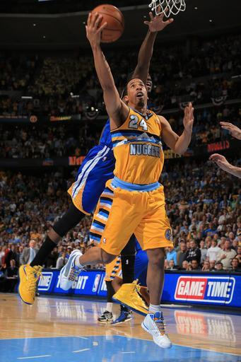 DENVER, CO - APRIL 20: Andre Miller #24 of the Denver Nuggets lays in the game winning shot against Draymond Green #23 of the Golden State Warriors with 1.2 seconds remaining in the game during Game One of the Western Conference Quarterfinals of the 2013 NBA Playoffs at the Pepsi Center on April 20, 2013 in Denver, Colorado. The Nuggets defeated the Warriors 97-95. (Photo by Doug Pensinger/Getty Images)