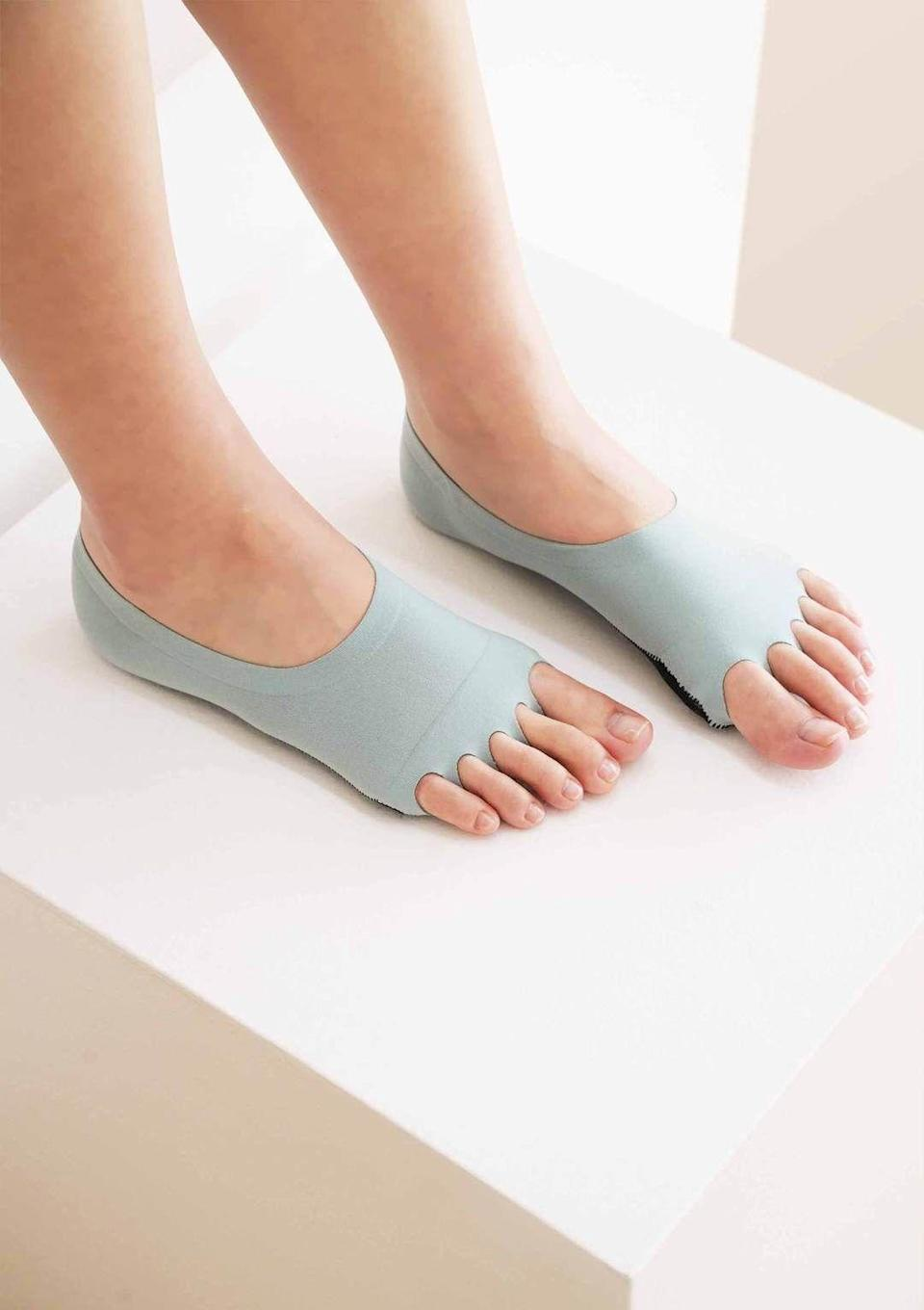 """<p><strong>Ondo </strong></p><p>ondo.com</p><p><strong>$24.00</strong></p><p><a href=""""https://ondo.com/products/yoga-socks-slate-grey?variant=39439041265749"""" rel=""""nofollow noopener"""" target=""""_blank"""" data-ylk=""""slk:Shop Now"""" class=""""link rapid-noclick-resp"""">Shop Now</a></p><p>One thing is clear: This is the sock to buy in bulk and stuff every barre and Pilates junkie's stocking with.</p>"""