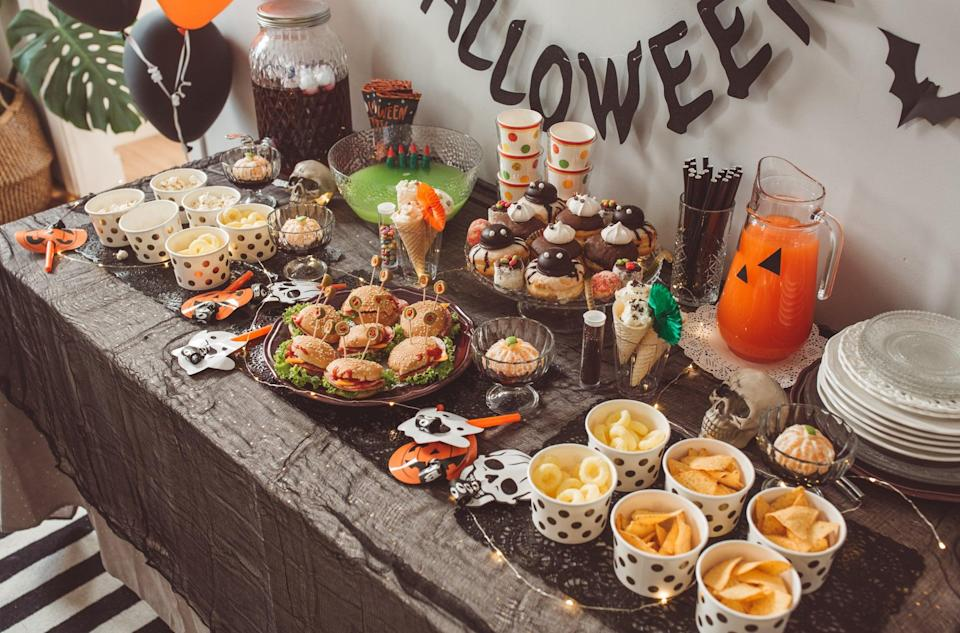 """<p>Even if you're only two people, a party is a party! Get out the decorations, make all of the themed snacks and drinks, turn up """"Monster Mash,"""" and dance in your costumes.</p>"""