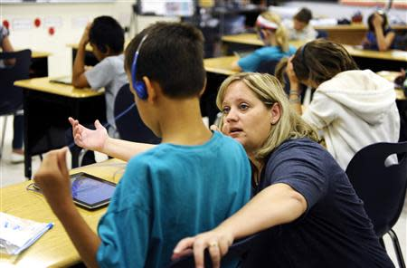 Fourth grade teacher Alicia Schoenborn works with a student at Mahnomen Elementary School in Mahnomen, Minnesota