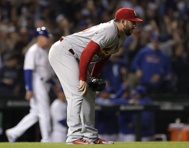 St. Louis Cardinals relief pitcher Dominic Leone reacts after Chicago Cubs' Kris Bryant hit a grand slam during the eighth inning of a baseball game, Sunday, May 5, 2019, in Chicago. (AP Photo/Nam Y. Huh)