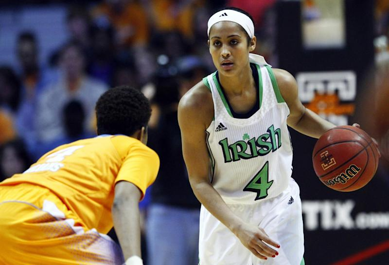 Notre Dame guard Skylar Diggins (4) brings the ball upcourt as she's defended by Tennessee guard Kamiko Williams (4) in the second half of an NCAA college basketball game on Monday, Jan. 28, 2013, in Knoxville, Tenn. Notre Dame won 77-67. (AP Photo/Wade Payne)