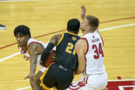 Arkansas-Pine Bluff's Shaun Doss (21) maneuvers between Wisconsin's Aleem Ford, left, and Brad Davison during the first half of an NCAA college basketball game Friday, Nov. 27, 2020, in Madison, Wis. (AP Photo/Andy Manis)