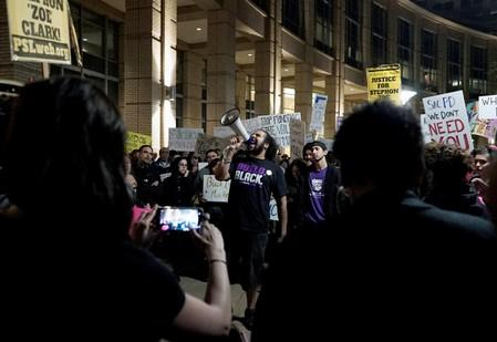 FILE PHOTO: Demonstrators gather outside City Hall to protest the police shooting of Stephon Clark, in Sacramento