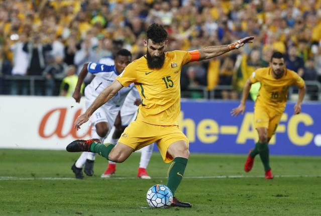 FILE - In this Wednesday, Nov. 15, 2017 filer, Australia's Mile Jedinak scores his second goal against Honduras during their World Cup soccer playoff deciding match in Sydney, Australia. (AP Photo/Daniel Munoz, File)