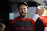 Washington Nationals starting pitcher Max Scherzer walks in the dugout during the fourth inning of a baseball game against the Cincinnati Reds at Nationals Park, Monday, Aug. 12, 2019, in Washington. (AP Photo/Alex Brandon)