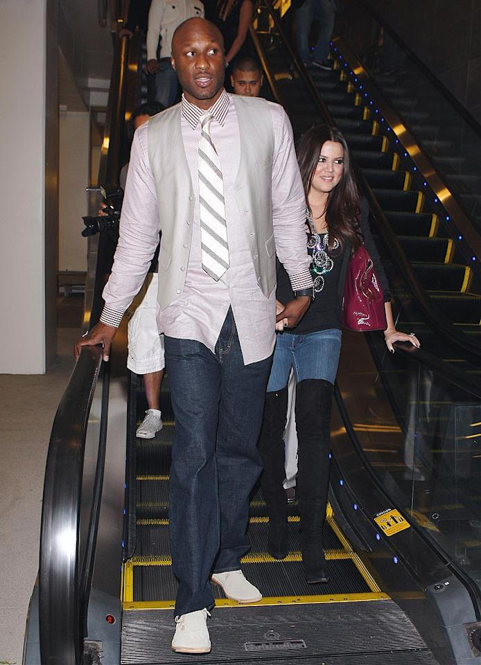 """Before the Taylors stole the spotlight, newlyweds Khloe Kardashian and Lamar Odom were Hollywood's hot couple. But what really matters is they're still hot for each other. This week the pair showed off new his-and-her tattoos -- they both got each other's initials tattooed on their hands. Maciel/<a href=""""http://www.x17online.com"""" target=""""new"""">X17 Online</a> - October 27, 2009"""