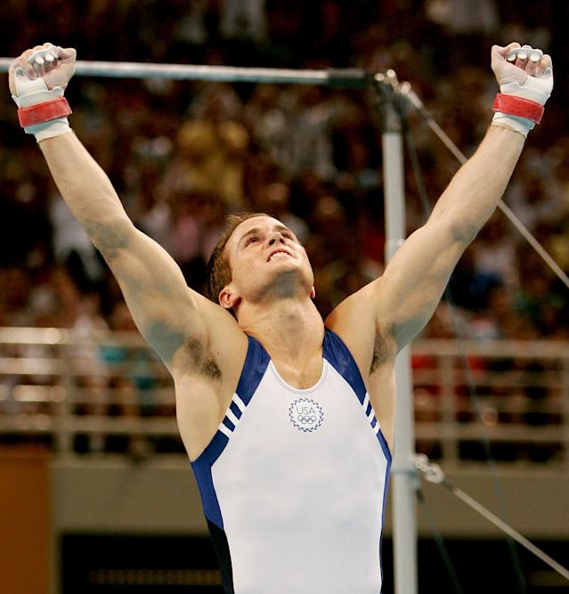 ATHENS - AUGUST 18: Paul Hamm of the USA celebrates after the horizontal bar at the men's artistic gymnastics individual competition on August 18, 2004 during the Athens 2004 Summer Olympic Games at the Olympic Sports Complex Indoor Hall in Athens, Greece. (Photo by Donald Miralle/Getty Images)