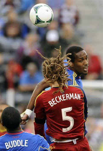 Colorado Rapids forward Atiba Harris, right, of St. Kitts, and Real Salt Lake midfielder Kyle Beckerman, left, fight for a header in the first half of an MLS soccer game in Commerce City, Colo., on Saturday, April 6, 2013. (AP Photo/Chris Schneider)