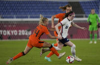 United States' Rose Lavelle, right, dribbles past Netherlands' Jackie Groenen during a women's quarterfinal soccer match at the 2020 Summer Olympics, Friday, July 30, 2021, in Yokohama, Japan. (AP Photo/Kiichiro Sato)