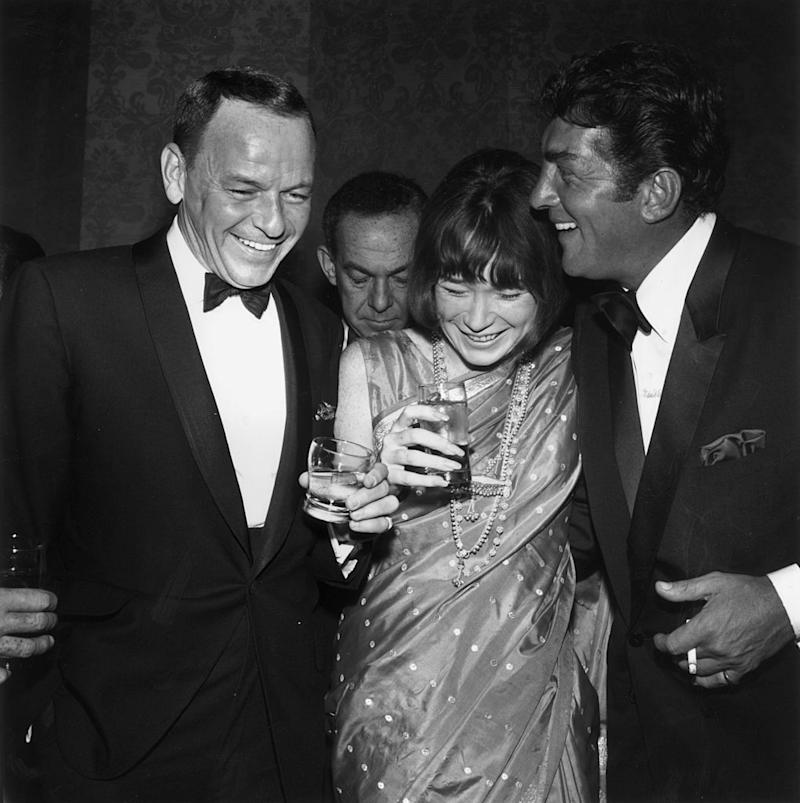 Frank Sinatra, Shirley MacLaine and Dean Martin spend a night out in 1965 Hollywood. (Photo: M. Garrett/Murray Garrett/Getty Images)
