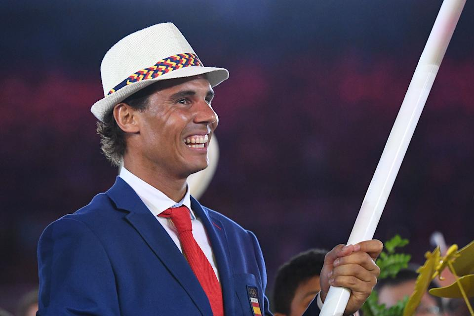 TOPSHOT - Spain's flag bearer Rafael Nadal leads  the delegation during the opening ceremony of the Rio 2016 Olympic Games at the Maracana stadium in Rio de Janeiro on August 5, 2016. / AFP PHOTO / Leon NEAL        (Photo credit should read LEON NEAL/AFP via Getty Images)