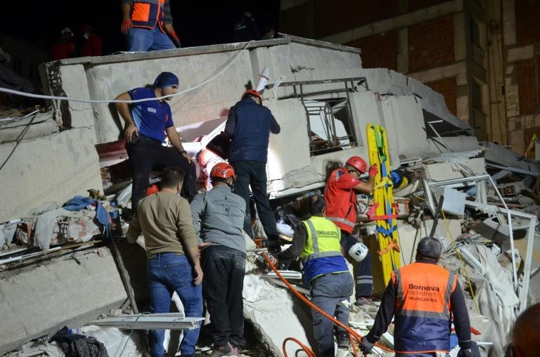 Rescuers search for survivors in a collapsed building in the Turkish city of Izmir after a powerful earthquake