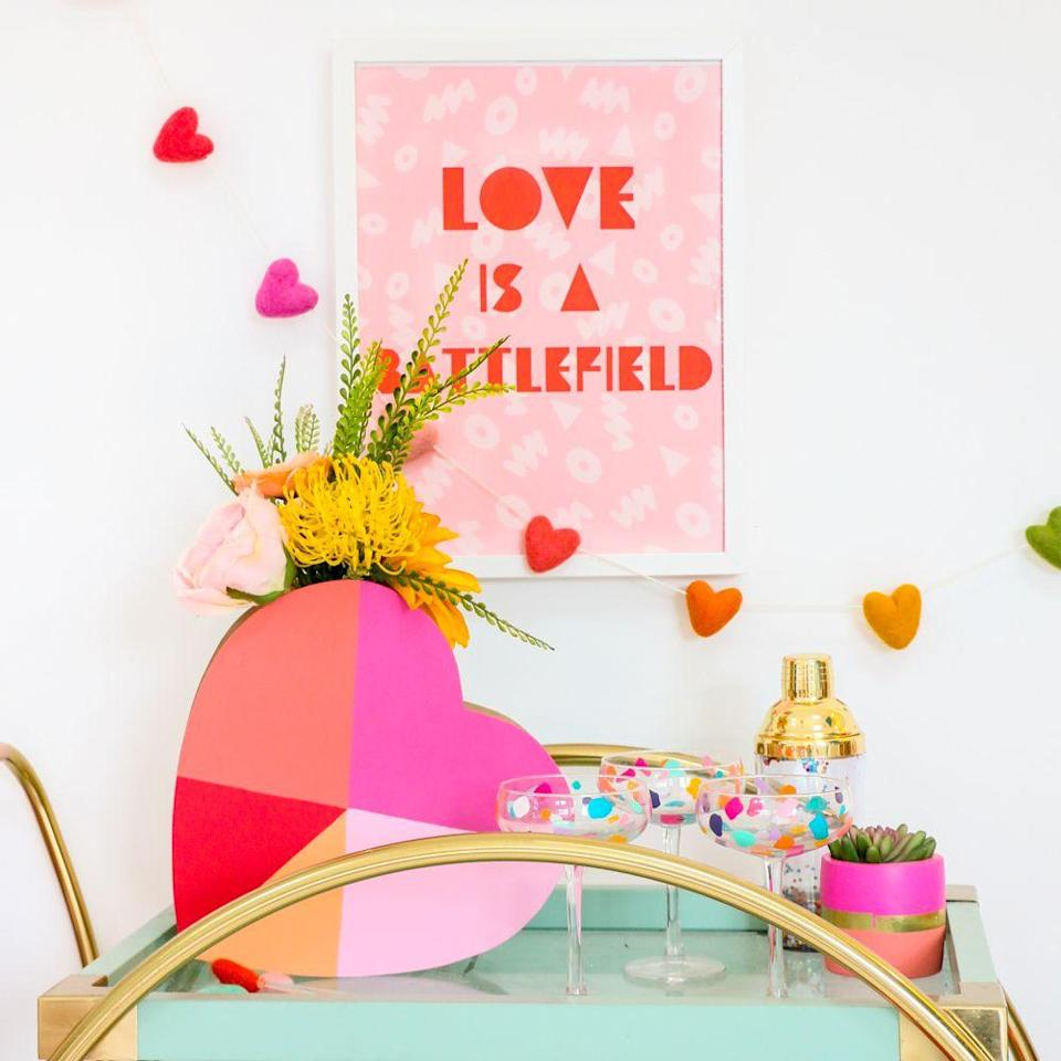 """<p>In this case, the vase is just as eye-catching as the flowers tucked inside. Pick a handful of contrasting paint shades to make a bold statement. </p><p><em><a href=""""https://akailochiclife.com/2020/01/how-to-make-geometric-heart-flower-vases.html"""" rel=""""nofollow noopener"""" target=""""_blank"""" data-ylk=""""slk:Get the tutorial at A Kailo Chic Life »"""" class=""""link rapid-noclick-resp"""">Get the tutorial at A Kailo Chic Life »</a></em></p>"""