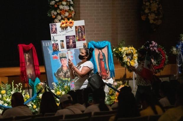 The gruesome death of soldier Vanessa Guillen, pictured in a photograph during a memorial event in Houston last year, has accelerated calls for U.S. military reform. (Marie D. De Jesus/Houston Chronicle via AP, Pool - image credit)