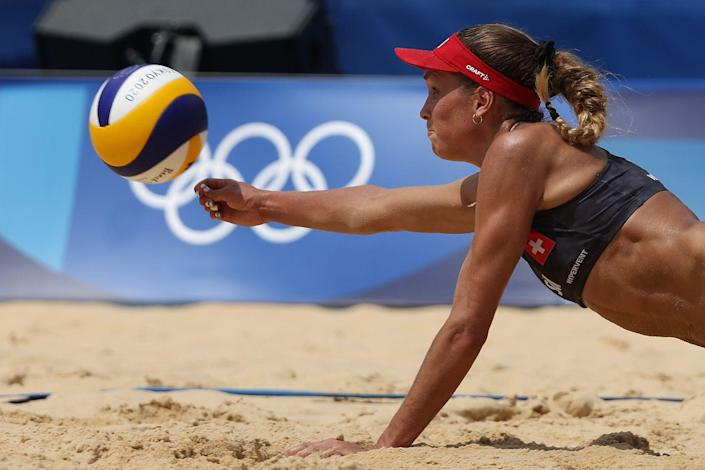 <p>Anouk Verge-Depre of Switzerland dives for the ball against Canada during the women's preliminary beach volleyball match.</p>