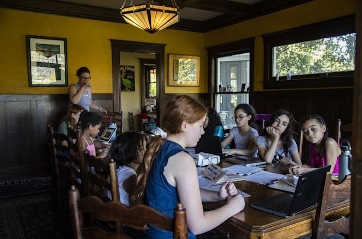 """Children from different families that are quarantining together are given a science presentation in Riverside in April. <span class=""""copyright"""">(Los Angeles Times)</span>"""